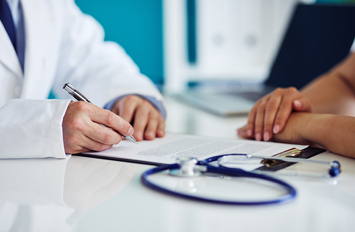 Doctor consults with patient to assess their health outcomes and experiences