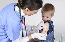 Child receiving an influenza vaccination